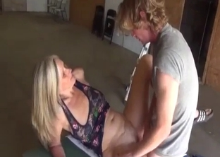 Leggy MILF fucking her hung son in the garage