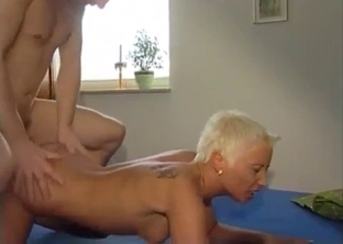 Short-haired and tanned MILF fucked by her son