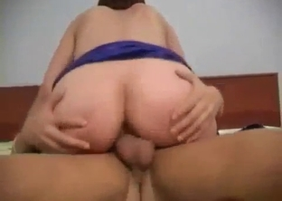 Short-haired MILF rides her son's massive dick