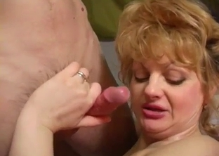 Fishnets-clad blonde MILF fucks her son